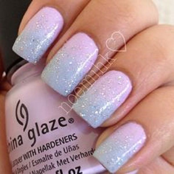 Baby Pink and Blue Ombre Nail Art with Glitter Polish on Top.