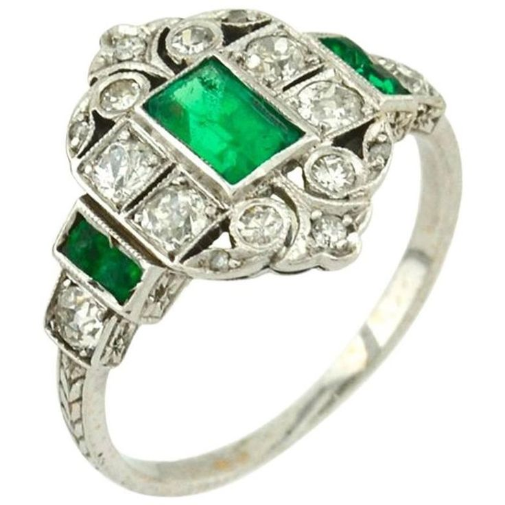 Art Deco 0.50 Carat Emerald and Diamond Platinum Ring | From a unique collection of vintage engagement rings at https://www.1stdibs.com/jewelry/rings/engagement-rings/