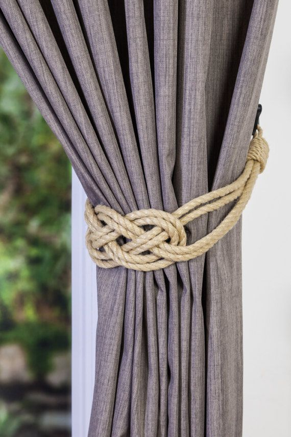 Double Carrick Bend knot Curtain tie-backs Beige Hemp rope. Carrick Bend Knot is 7 wide. Cotton rope doesnt stretch or shrink. Suitable for indoor and outdoor use. Tiebacks do not come with hard ware. Other colour variations are also available : Ivory white and Charcoal Gray.