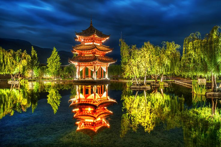 Tom and I visited this Pagoda late one evening in Li Jiang. There was zero wind, so the perfect reflection made us happy. The thing that did not make us happy was having to get on the ground with our tripods in the lowest position. - Li Jiang, China - Photo from #treyratcliff Trey Ratcliff at http://www.stuckincustoms.com/
