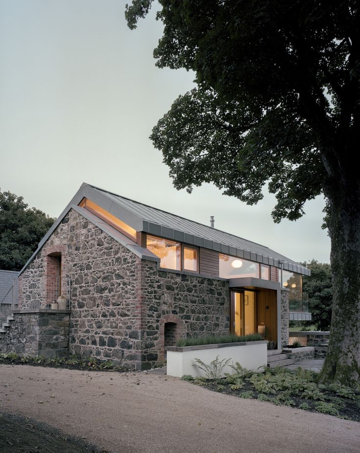 Interesting idea to lift the roof to add some glass above the stone walls.