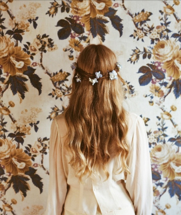 Elegant look perfect for those bad hair days. Flowers, braids, waves and you're ready to go.