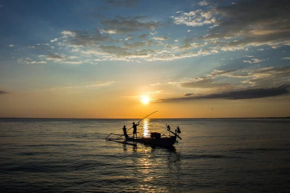 fishermen return at dusk