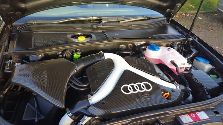 Hydrographic printing, Black and Silver carbon fiber weave applied to Audi A6 engine bay parts.
