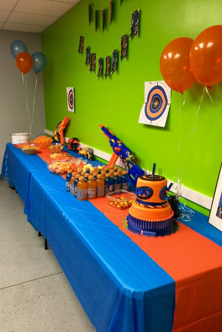 Nerf party food and cake table nerf gun party for Decoration ideas 7th birthday party