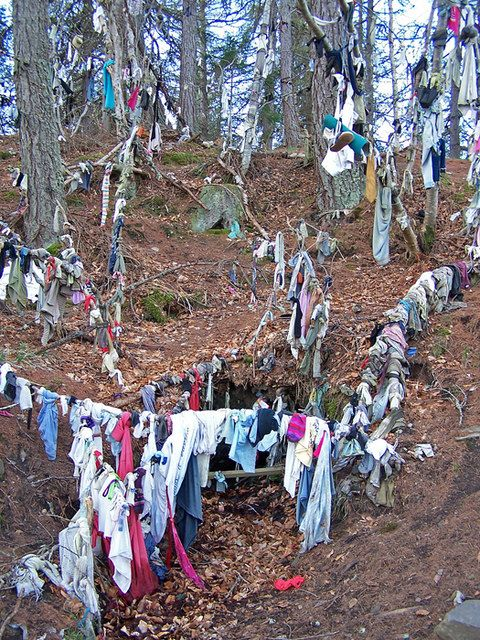 An example of a Clootie Well. It is a pagan tradition in Celtic lands for a pilgrim to leave a clootie (i.e. rag) at a sacred well or spring, typically tying it to a nearby tree...