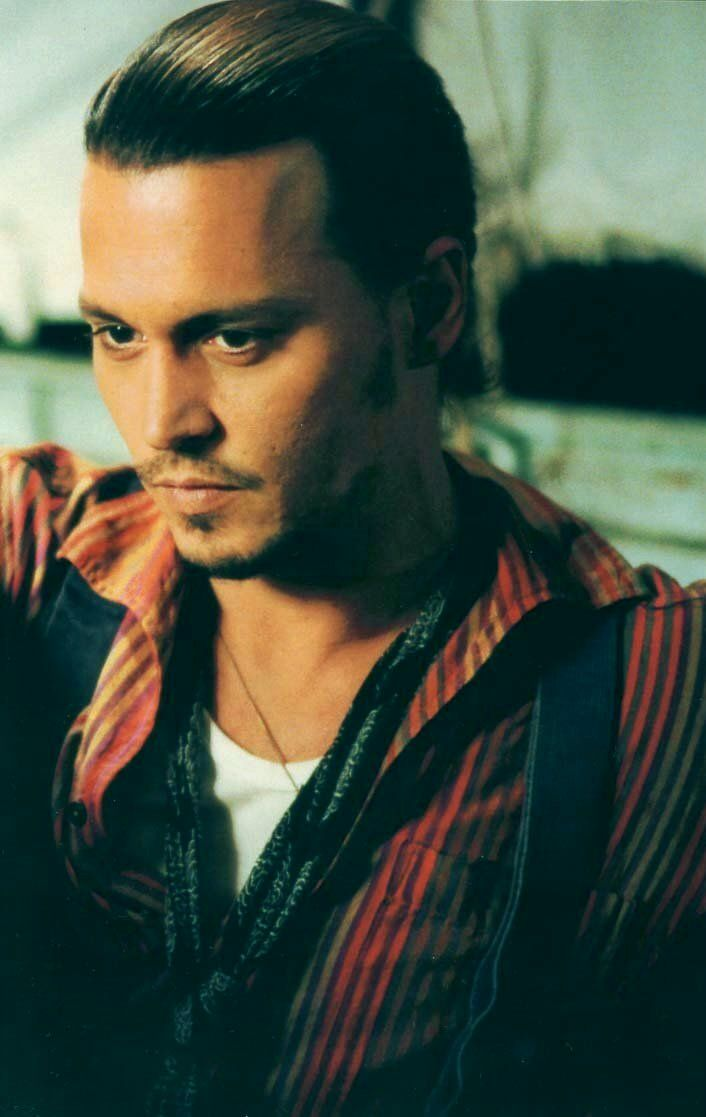 "Johnny Depp in his role as the gypsy Roux in the film ""Chocolat."""