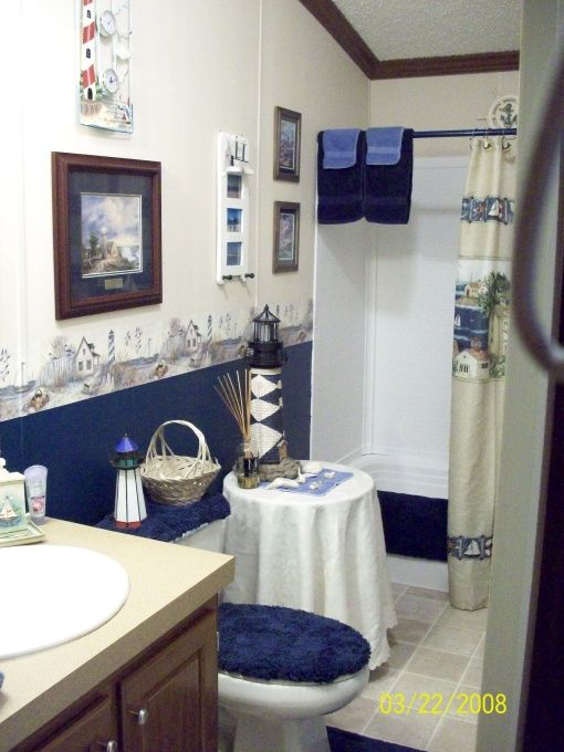 blue lighthouse bathroom  was all beige  add alittle color  was all beige. 17 Best ideas about Lighthouse Bathroom on Pinterest   Lighthouse