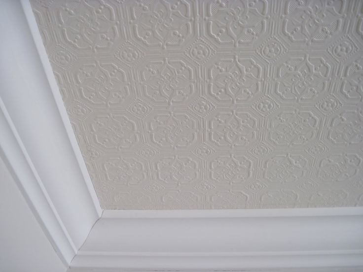 Textured wallpaper on the ceiling...this is an inexpensive way to get the look of tin ceiling tiles.