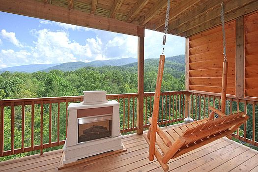 Gatlinburg Cabins - Whispering Creek -1 Bedroom.  A 1 bedroom romantic cabin featuring a majestic views of the great smoky mountains, outdoor hot tub, and nearby stream!