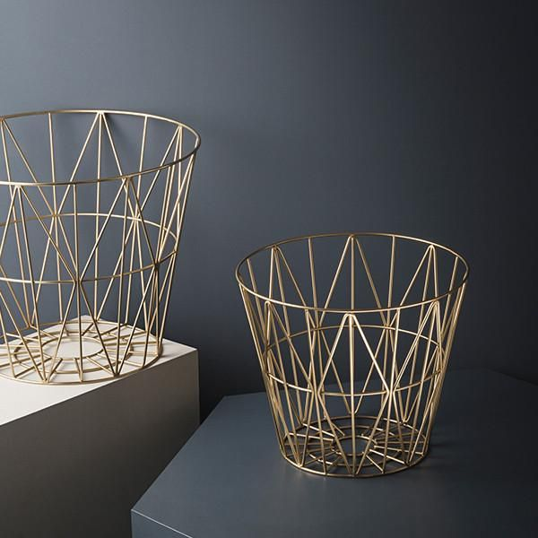 This multi-functional wire basket from Ferm Living is plated with shining brass with decorative and graphic lines. Available in three sizes, these baskets can h