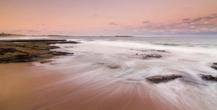 The flow of water around the rocks at sunset - Cronulla NSW Australia