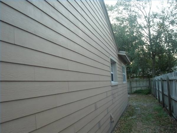 How To Repair A Section Of Exterior Composite Siding Hunker Composite Siding Siding Repair Exterior