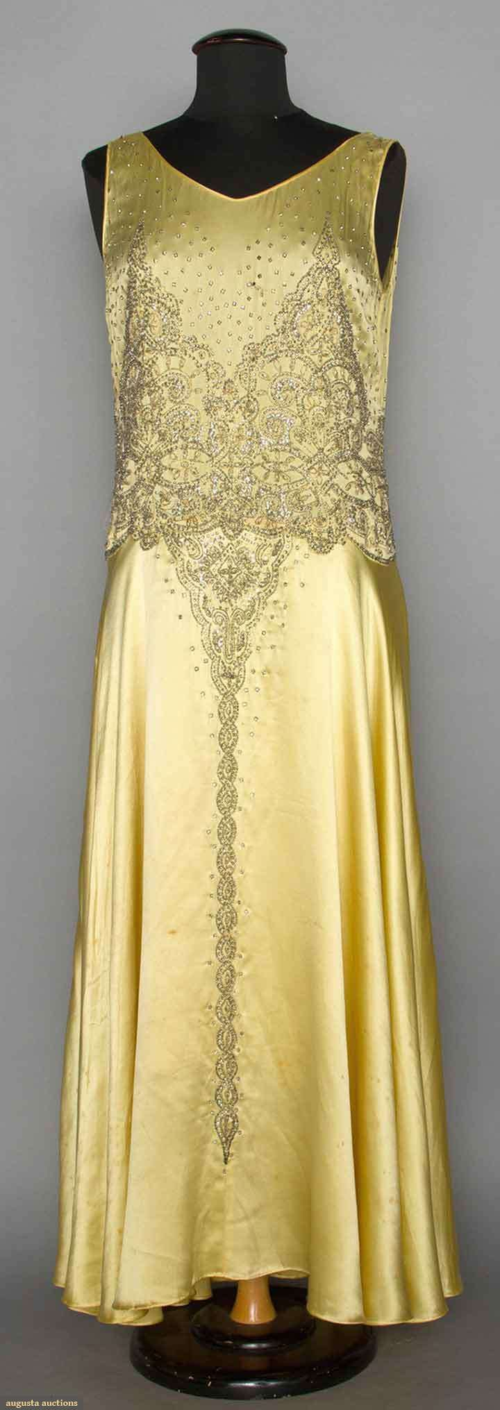 TWO SILK SATIN EVENING GOWNS, 1930s 1 yellow silk satin w/ silver beaded & sequined bodice; 1 black w/ lace trim.