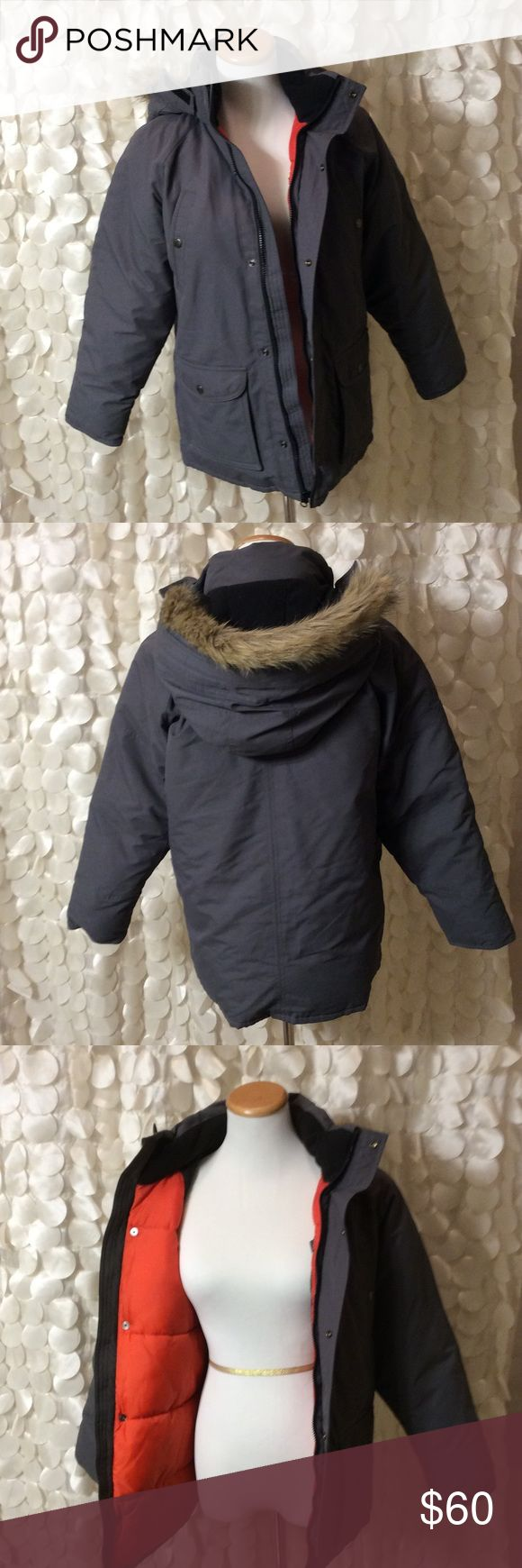 Grey Hooded Boys Winter Coat This new with tags Gap grey winter coat is super warm. The hood has a remove able faux fur trim. Never worn, no flaws. GAP Jackets & Coats Puffers