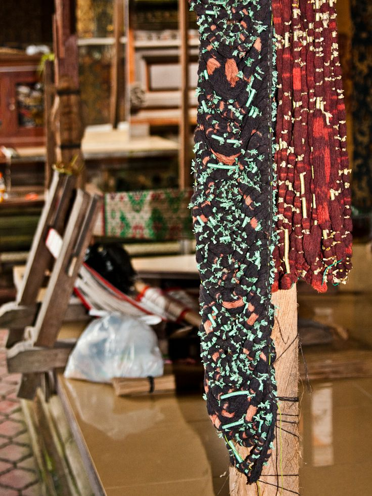 Thread for double ikat is dyed and then aged for long periods to acquire the desired tone. Tenganan, Bali.