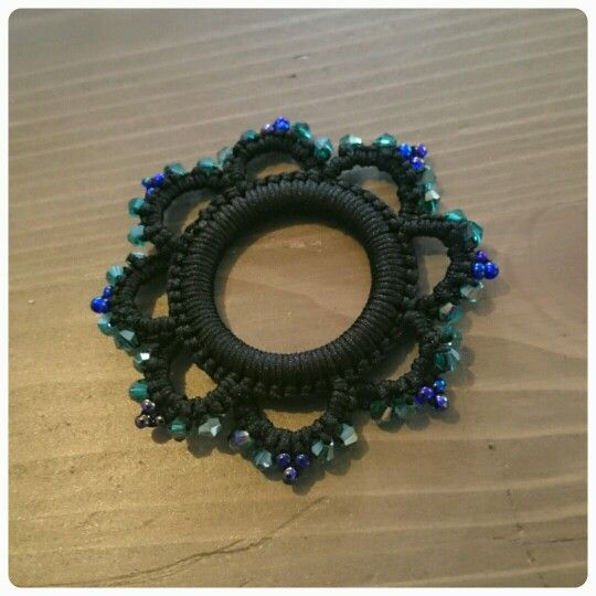 Crochet around the ring, then needletatting chains with seedbeads around the ring. Simple but beautiful!