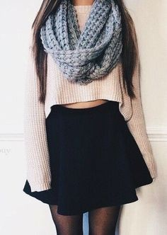 knitted scarf with cropped nude top and black skirt christmas outfit idea