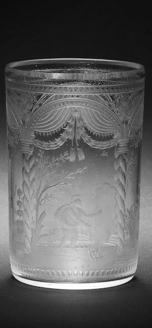 A rare Bohemian engraved allegorical beaker by Franz Riedel, Isergebirge, circa 1800-10 The cylindrical form finely decorated with four arched panels and twisted columns enclosing putti emblematic of the Four Seasons, below fancy drapery and floral swags, all between formal dotted borders, 10.8cm high