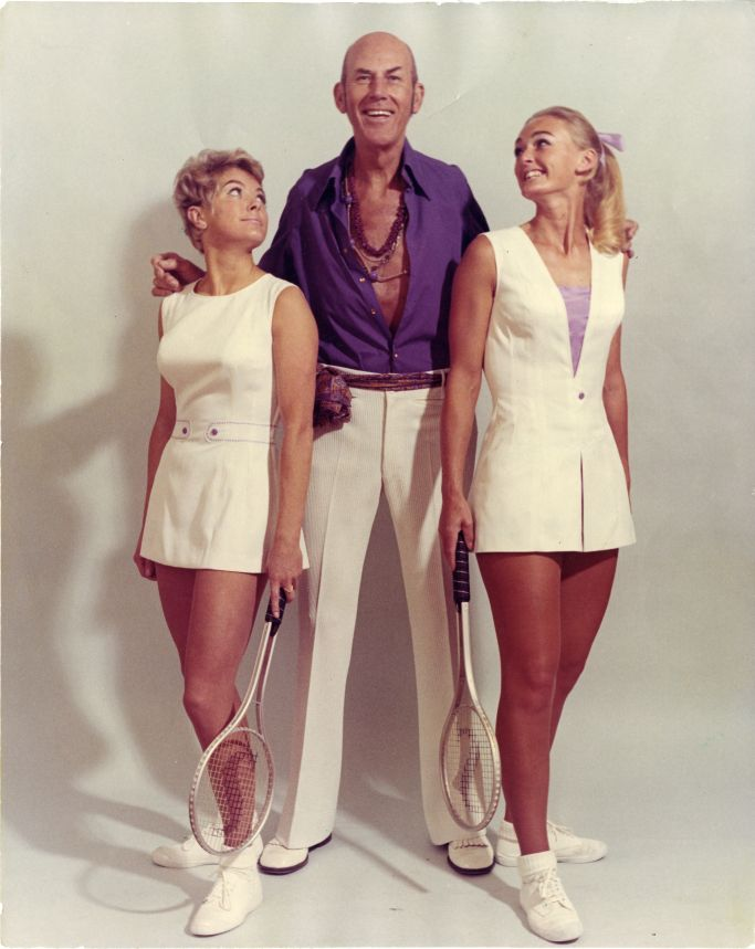 "Cuthbert Collingwood ""Ted"" Tinling poses with models dressed in his tennis designs in this undated photo."