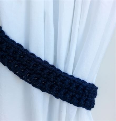 Solid Dark Navy Blue CURTAIN TIEBACKS - One Pair, 22 long x 2.25 wide x 1/2 thick   One Pair of Hand-Crocheted Curtain Tiebacks for use with any kind of curtains or drapes, including shower curtains. I used a very thick 100% acrylic yarn called Hometown USA. The color is called San Diego Navy, a basic dark navy blue. This yarn is very soft, smooth, and has a slight sheen.   Different monitors/screens can display colors differently, so If an exact match is needed, I can send swatches...