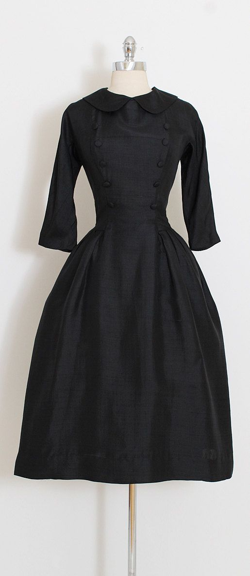 ➳ vintage 1950s dress  * black silk dupioni * covered button details * acetate and muslin linings * metal back zipper * cropped sleeves * fabulous design inspired by Dior * Suzy Perette  condition   excellent fits like medium  length 45 bodice length 17 bust 38-40 waist 28  some clothes may be clipped on dress form to show best fit for appropriate size.  ➳ shop http://www.etsy.com/shop/millstreetvintage?ref=si_shop  ➳ shop policies http://www.etsy.com/...