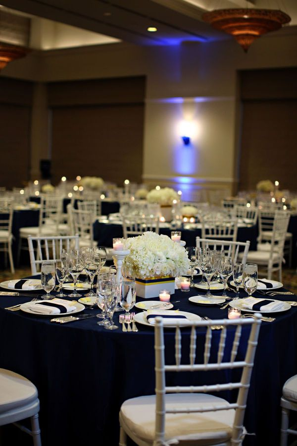 Blue and white wedding reception... but with raised flower arrangements!