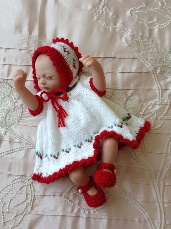 Hand knitted Christmas themed dolls clothes to fit 10