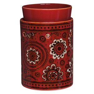 Wrap your home in bohemian whimsy with this spirited red warmer, hand painted with fanciful flowers and swirls.