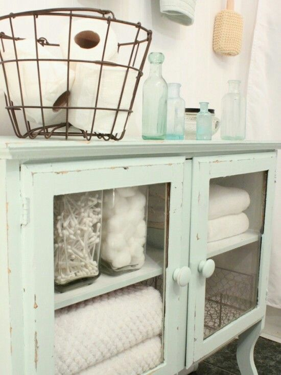 Vintage Bathroom idea. I love the soft green and rust metal together.