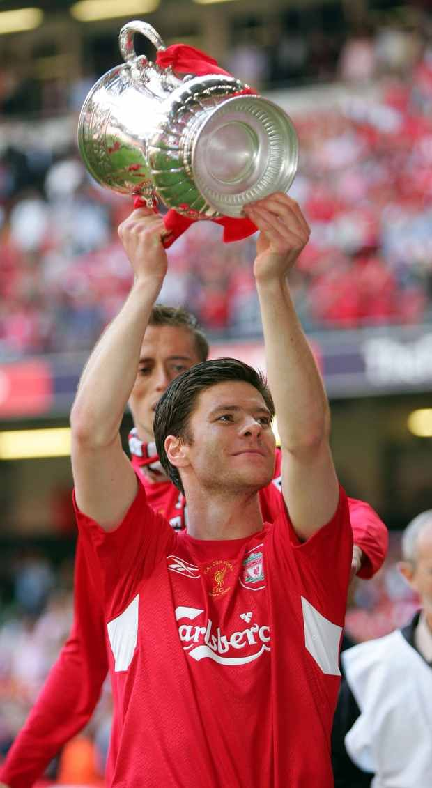CARDIFF, WALES - SATURDAY, MAY 13th, 2006: Liverpool's Xabi Alonso celebrates winning the FA Cup after a penalties victory over West Ham Uni...