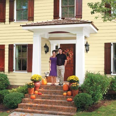 For just $996, this couple gave the flat, unwelcoming facade of their Colonial Revival a front-entry face-lift with a DIY portico addition. | Photo: Deborah Whitlaw Llewellyn | thisoldhouse.com