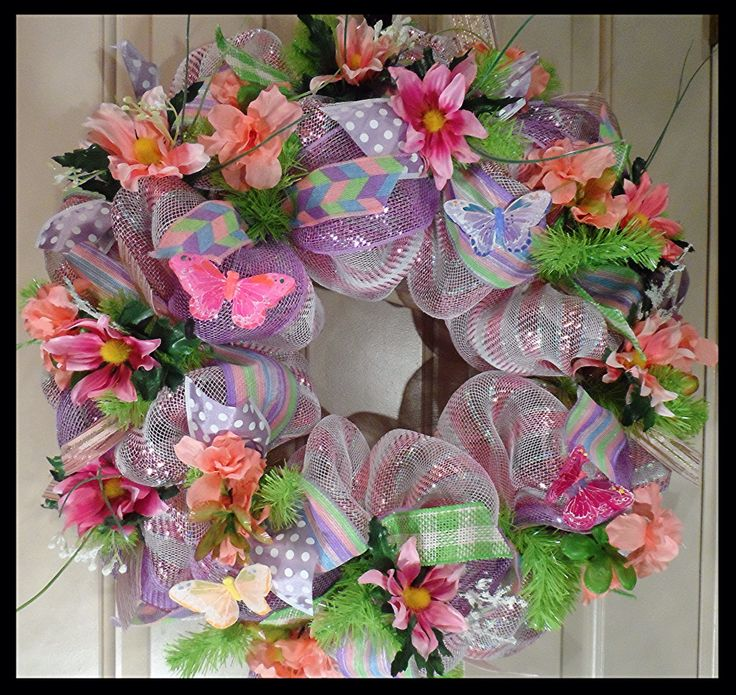 Lovely pink and lavender Spring Wreath from www.facebook.com/overthetopwreaths