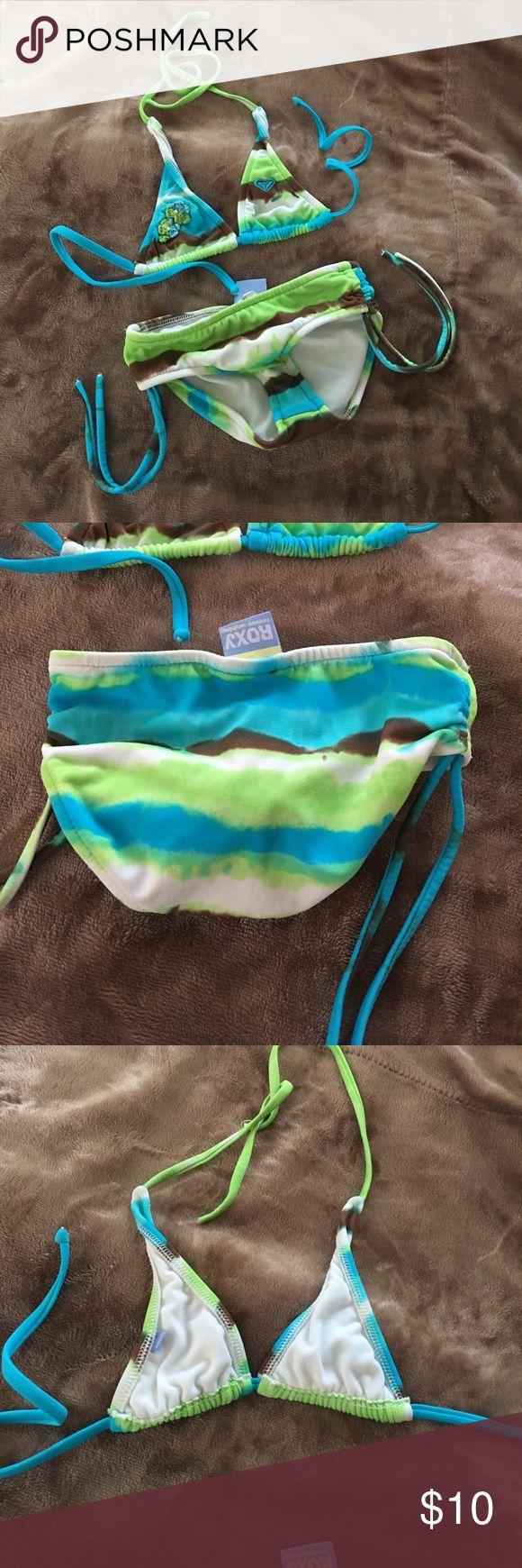 Roxy bathing suit Used but still in good condition. Size 4 fits 12-18 mos best Roxy Swim Bikinis