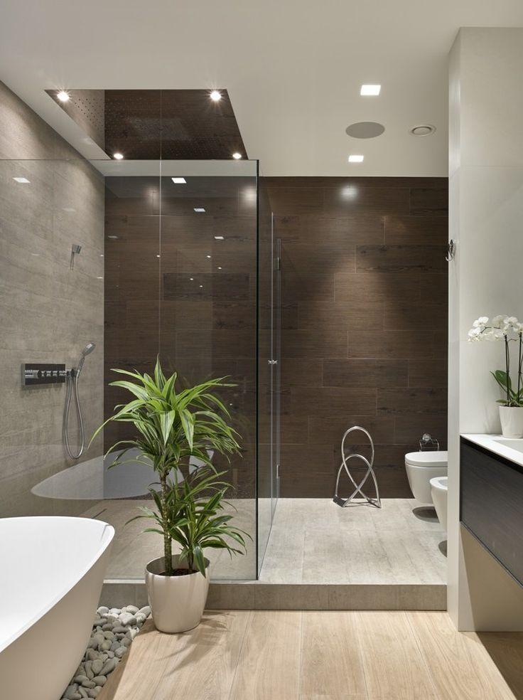 Master bathroom, wood grain tile floor and wall, glass shower, free standing tub on stones | Fedorova