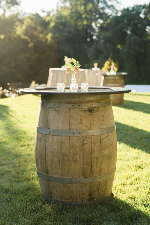 Want to give your outdoor wedding a vineyard vibe? Old wine barrels are the perfect height to be repurposed as rustic cocktail tables.