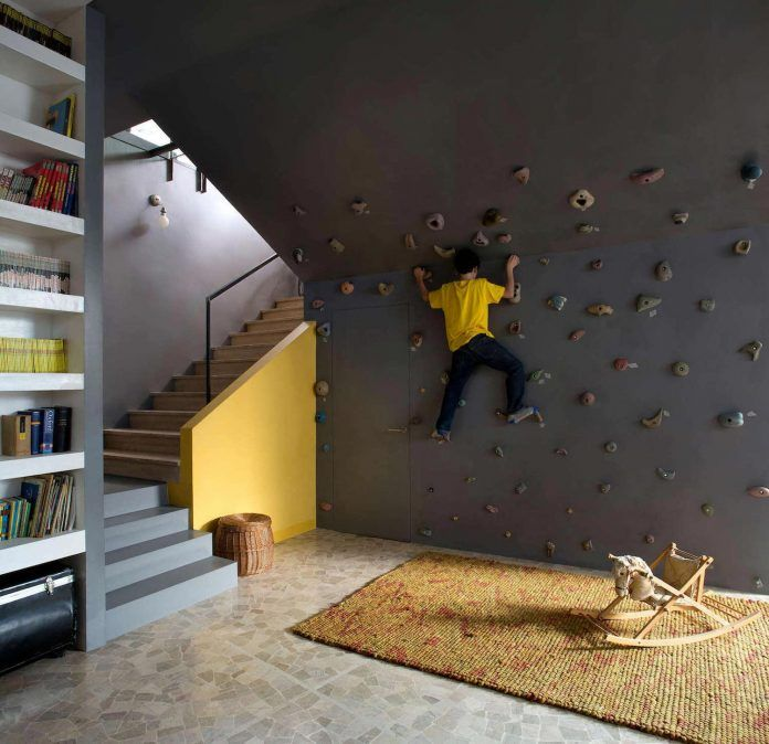 Fun home with lots of contrasting materials and colors has also a climbing wall inside it - CAANdesign | Architecture and home design blog