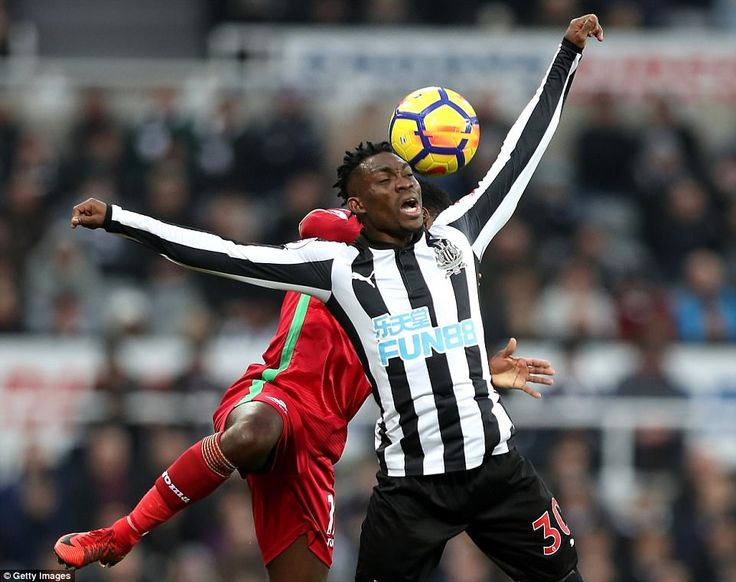 Christian Atsu attempts to win a header against Nathan Dyer but the Newcastle winger feels he was fouled in the process