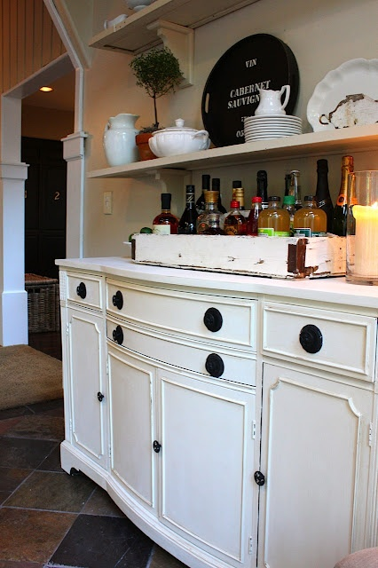 great use of a dresser (complete with tons of storage) turned buffet in this dining room...love the cute bar on top.