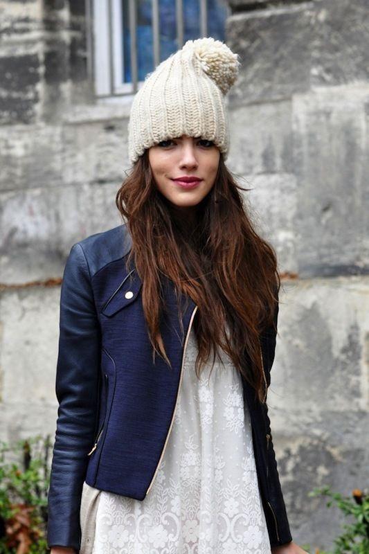 Shop this look on Lookastic:  https://lookastic.com/women/looks/navy-biker-jacket-beige-cardigan-white-shift-dress/14273  — Beige Beanie  — Navy Leather Biker Jacket  — Beige Cardigan  — White Lace Shift Dress