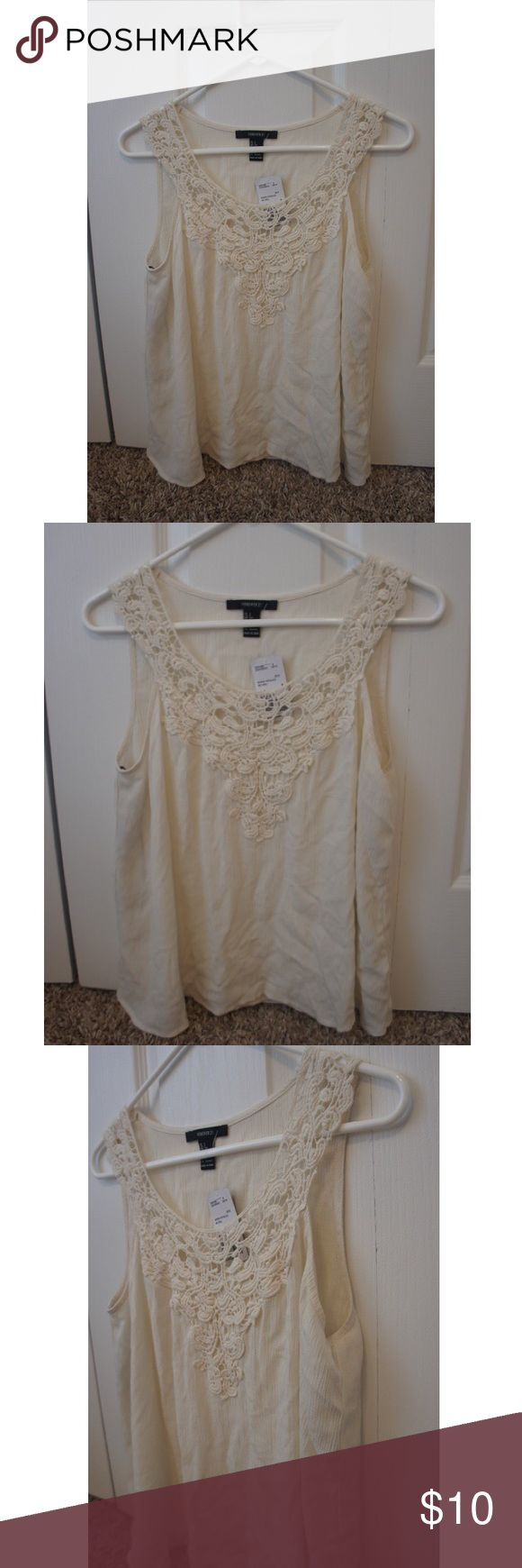 never worn, tags still attached, cream women's top cream 100% rayon shell and cotton women's sleeveless top with woven detailing at the top; never worn and tags still attached! Forever 21 Tops Tank Tops