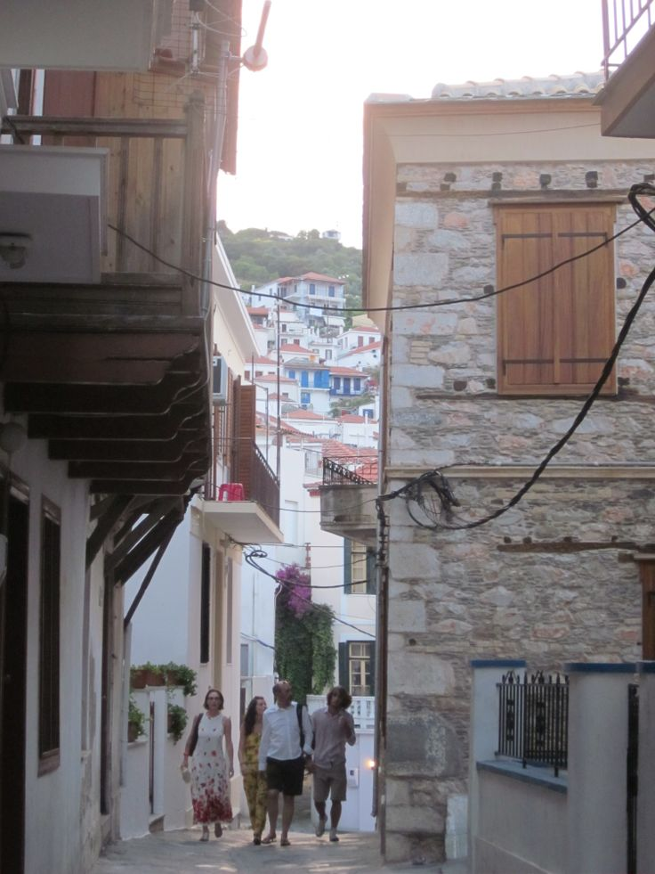 Tourists walking through the island alleys