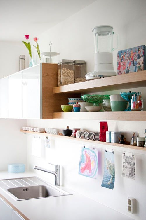 I like the combo closed storage, floating shelf open storage, and kid art display. Next kitchen. :)