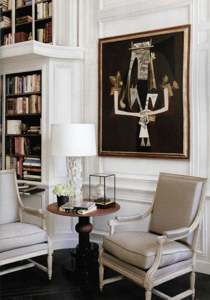 Paris apartment of Lauren Santo Domingo. Designer Francois Catroux. Via Vogue Sept. 2012. Photography by Norman Jean Roy. Love the boiserie and side table