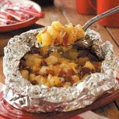 "cheesy grilled potatoes. a favorite grilling side dish for steaks, chicken, chops, or burgers.  aka - ""hobo packs"""