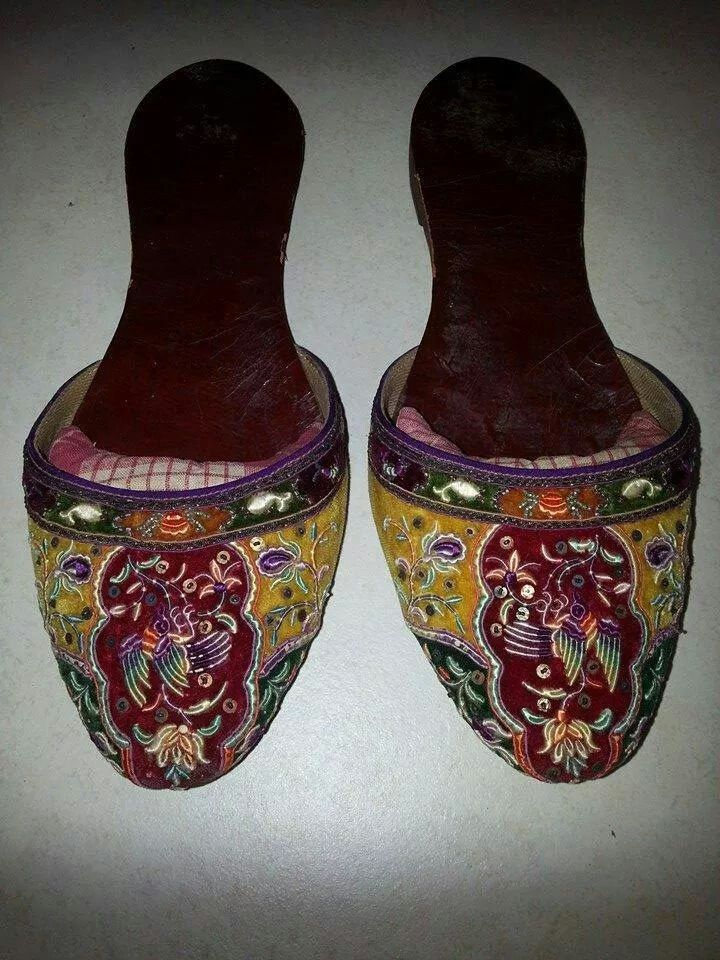 "A pair ofPeranakan beaded  embroidried slippers known as ""Kasut Manek-Manek""...sewn by Nonya's  , then sent to the Cobbler to be made...now a dying craft."