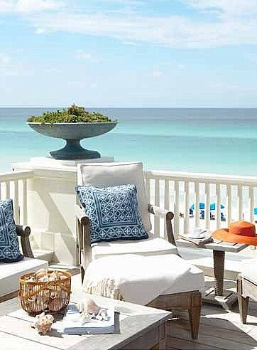 beautiful beach peace spot....white and navy with wicker and shells. Upscale coastal beach house deck decor ideas.