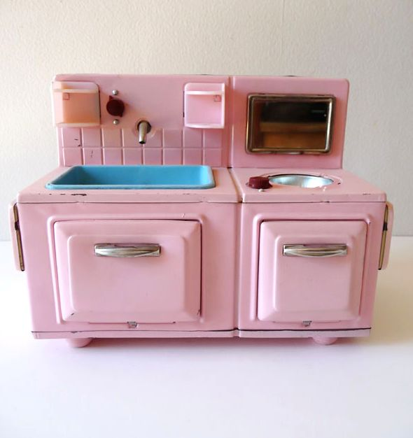 little 50s toy kitchen! Our real kitchen had a pink fridge and pink