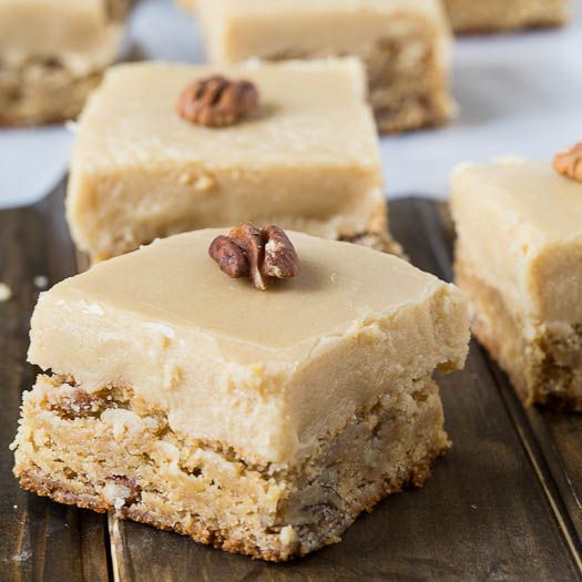 Butterscotch Blondies with pecans and a thick layer of heavenly icing.