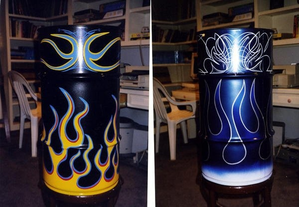 Pin-striped and flamed 55 gallon drums.